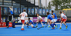 England's Sam Ward (right) scores his side's third goal of the game against Korea during the Men's World Hockey League match at Lee Valley Hockey Centre, London.