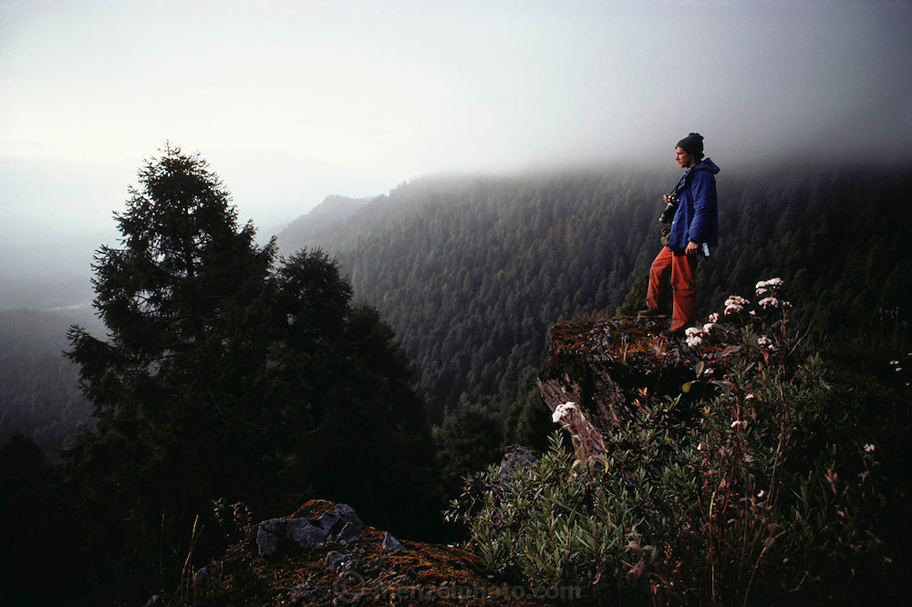 Self portrait of photographer Peter Menzel overlooking the Monarch butterfly reserve. Site Alpha, near Rosario, Mexico.