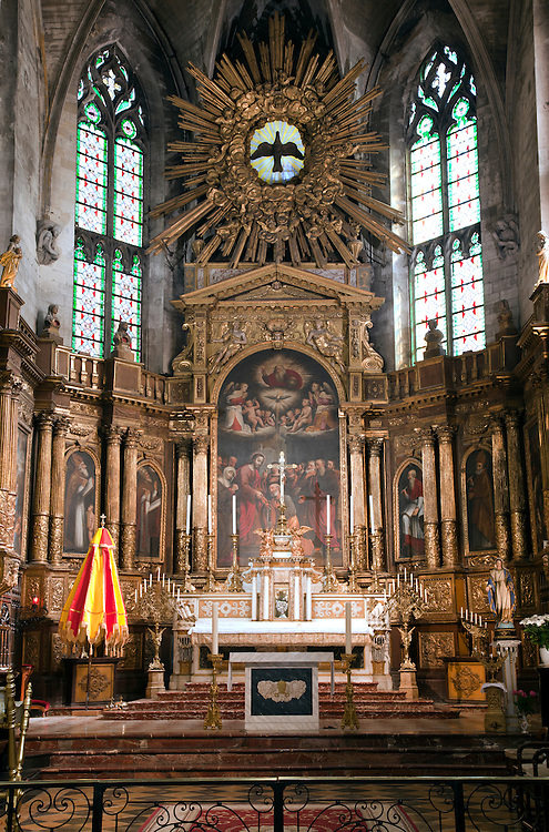 Church of Saint Pierre in Avignon in Provence, France, is known for its gilded high Renaissance altar (1617-34) and its massive, heavily carved walnut doors.