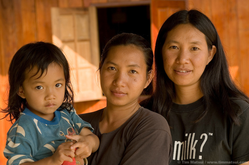 Sisters Ayee, right, and Booka with Booka's four year-old son Nalin in the the Akha hill tribe town of Senjai near Mae Sai, northern Thailand. Ayee was sold as a young girl to a German who took her to Germany; she returned months later to find her younger sister Booka living and studying at DEPDC where her risk of being trafficked like Ayee was minimized. Soon Ayee moved to the DEPDC facility where she learned how to cope with her experience; today as a woman in her mid-thirties she is an advocate for women's and children's rights works in her 50,000 person municipality to end human trafficking...DEPDC is addressing the issue of human trafficking in northern Thailand by providing a safe place to live and study for youth who are at risk of being trafficked.