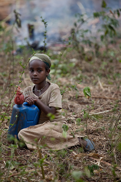 Girl with blue jerry can in Bale Mountains National Park, Ethiopia