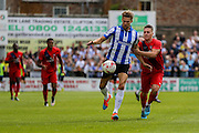 Glenn Loovens and Josh Carson during the Friendly match between York City and Sheffield Wednesday at Bootham Crescent, York, England on 18 July 2015. Photo by Simon Davies.