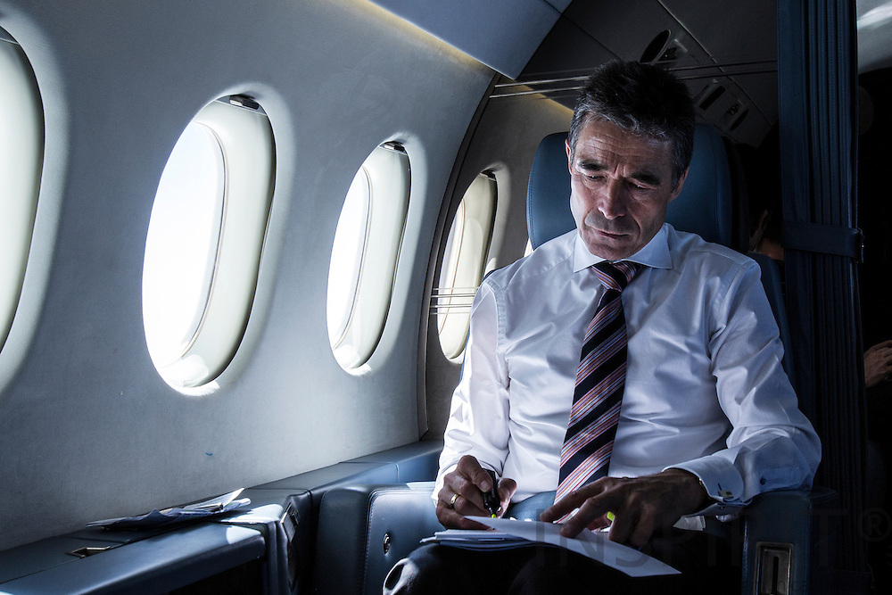 NATO Secretary General Anders Fogh Rasmussen working while flying from Madrid and Rome 26 April 2012. Photo: Erik Luntang