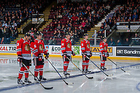 KELOWNA, CANADA - JANUARY 28: Caleb Jones #3, Evan Weinger #25, Jake Gricius #14, Matthew Quigley #5 and Skyler McKenzie #43 of the Portland Winterhawks line up on the blue line against the Kelowna Rockets on January 28, 2017 at Prospera Place in Kelowna, British Columbia, Canada.  (Photo by Marissa Baecker/Shoot the Breeze)  *** Local Caption ***