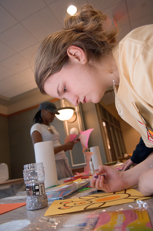 McKenzie Koss making cards to put in the luggage for the children. ...Off-Campus and Community Services presents Martin Luther King Jr. Day Love Luggage Project Love Luggage is a service project to decorate second-hand suitcases and fill them with necessities and small gifts for children in foster and shelter care. Donations are needed: suitcases, toiletries, art supplies, school supplies, books, journals, and small toys.