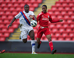 LIVERPOOL, ENGLAND - Saturday, January 8, 2011: Liverpool's Raheem Sterling and Crystal Palace's Aaron Akuruka during the FA Youth Cup 4th Round match at Anfield. (Pic by: David Rawcliffe/Propaganda)