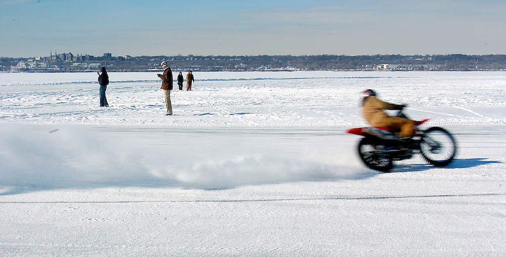 Motorcycle racing on the frozen waters of the Illinois River near East Peoria, Illinois. ©David Zalaznik