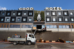 © Licensed to London News Pictures. 13/10/2016. LONDON, UK.  The Good Hotel arrives in the lock at Royal Victoria Dock in east London today after being towed by tugs 288 nautical miles from Amsterdam. Originally built in 2007 to house illegal immigrants, the prison barge was converted five years later into The Good Hotel. The barge will be moved into the main dock soon, where it will moor and become a 144 room hotel at a reported £110 per night.  Photo credit: Vickie Flores/LNP