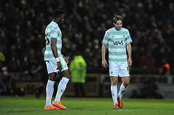 Dejection for Yeovil Town's Gozie Ugwu and Yeovil Town's Sam Foley as Bristol City's Kieran Agard scores his sides goal - Photo mandatory by-line: Harry Trump/JMP - Mobile: 07966 386802 - 10/03/15 - SPORT - Football - Sky Bet League One - Yeovil Town v Bristol City - Huish Park, Yeovil, England.