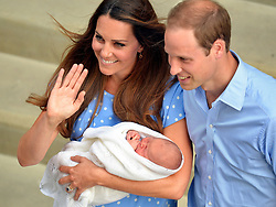 File photo dated 23/07/13 of the Duke and Duchess of Cambridge with their son Prince George of Cambridge as the royal couple will be waiting on tenterhooks to see if their new baby is a boy or a girl Ð as they do not know their childÕs gender.