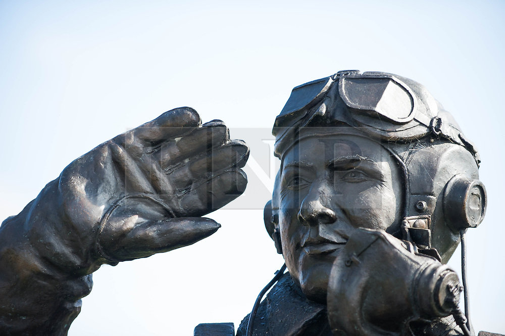 © Licensed to London News Pictures. <br /> 28/08/2014. <br /> <br /> Durham Tees Valley Airport, United Kingdom<br /> <br /> A service takes place at the statue of Pilot Officer Andrew Mynarski at Durham Tees Valley airport today ahead of the visit by one of two remaining flying Avro Lancaster bombers.<br /> <br /> Pilot Officer Andrew Mynarski who flew with the Canadian Royal Air Force from the airport which was then called RAF Middleton St George was posthumously awarded a VC after giving his life while trying to save a colleague when their Lancaster was shot down in June 1944.<br /> <br /> The famous World War Two aircraft is owned by the Canadian Warplane Heritage Museum and is beginning a 2-week tour of the UK.<br /> <br /> Photo credit : Ian Forsyth/LNP