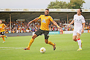 Cambridge Utd defender Leon Legge (6) clears the ball from Luton Town forward Danny Hylton (9) during the EFL Sky Bet League 2 match between Cambridge United and Luton Town at the R Costings Abbey Stadium, Cambridge, England on 27 August 2016. Photo by Nigel Cole.