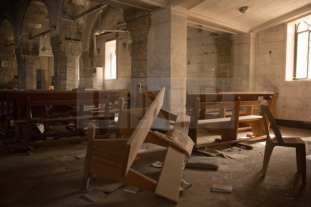 Licensed to London News Pictures. 23/10/2016. A chapel in the Mart Shmony Church, ransacked by Islamic State militants, is seen in the Iraqi town of Bartella.<br /> <br /> Bartella, a mainly Christian town with a population of around 30,000 people before being taken by the Islamic State in August 2014, was captured two days ago by the Iraqi Army's Counter Terrorism force as part of the ongoing offensive to retake Mosul. Although ISIS militants were pushed back a large amount of improvised explosive devices are still being found in the town's buildings. Photo credit: Matt Cetti-Roberts/LNP