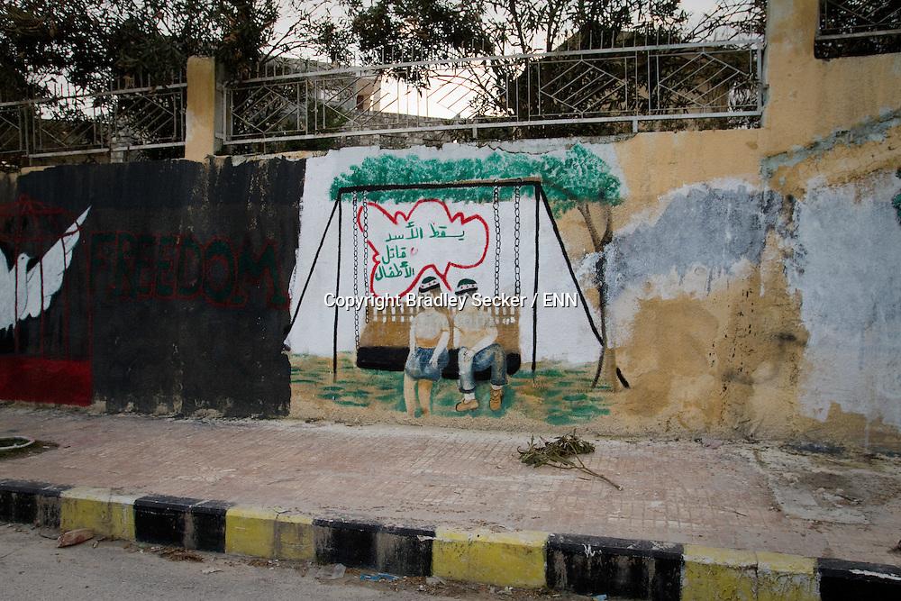 Anti regime graffiti on a wall in the town of Al Janoudiyah, Idlib province, Syria