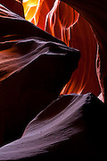Light from above enters the Upper Antelope Canyon and reflects off the walls lighting them up in several colors