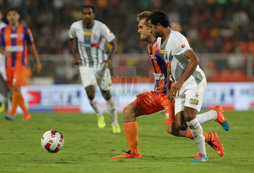 Davide Colomba of FC Pune City and Kinshuk Debnath of Atletico de Kolkata in action during match 44 of the Hero Indian Super League between FC Pune City and Atletico de Kolkata FC held at the Shree Shiv Chhatrapati Sports Complex Stadium, Pune, India on the 29th November 2014.<br /> <br /> Photo by:  Vipin Pawar/ ISL/ SPORTZPICS