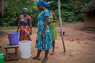 Mothers filter contaminated river water with a powerless water filtration system provided by Ghanaian Mothers Hope near Akosombo, Ghana, Thursday, July 27, 2017. Ghanaian Mothers' Hope is a US based non-profit working to bring clean water, education, and healthcare to Ghanaian Villages in need.