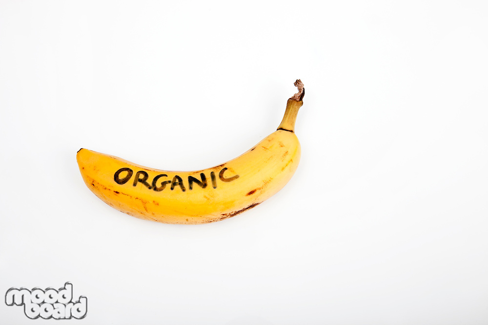 Organic banana against white background