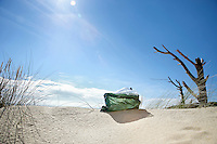 Rubbish bag on sand dune
