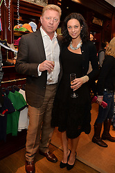 BORIS & LILLY BECKER at the 4th birthday party for Amadeus Becker, son of Boris & Lilly Becker held at Ralph Lauren, 143 New Bond Street, London on 9th February 2014.