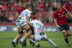 October 20, 2018 - Limerick, Ireland - Sammy Arnold of Munster tackled by Tom Hudson and Jake Polledri of Gloucester during the Heineken Champions Cup match between Munster Rugby and Gloucester Rugby at Thomond Park in Limerick, Ireland on October 20, 2018  (Credit Image: © Andrew Surma/NurPhoto via ZUMA Press)