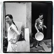 Portrait of two young vietnamese women living along the railway of Hanoi, Vietnam, Southeast Asia