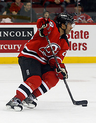 February 18, 2008; Newark, NJ, USA;  New Jersey Devils defenseman Johnny Oduya (29) skates with the puck during the first period at the Prudential Center in Newark, NJ.