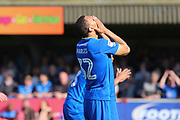 AFC Wimbledon defender Darius Charles (32) with head in hands during the EFL Sky Bet League 1 match between AFC Wimbledon and Bristol Rovers at the Cherry Red Records Stadium, Kingston, England on 8 April 2017. Photo by Matthew Redman.