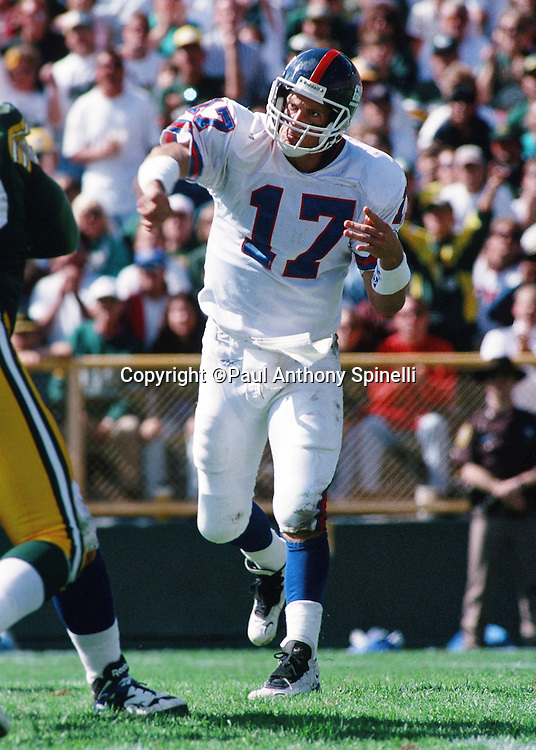 An official throws a penalty flag while New York Giants quarterback Dave Brown (17) has an intense look on his face as he releases a pass during the NFL football game against the Green Bay Packers on Sept. 17, 1995 in Green Bay, Wis. The Packers won the game 14-6. (©Paul Anthony Spinelli)