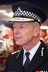 Ealing, London, December 9th 2014. Mayor of London Boris Johnson visits Ealing accompanied by Met Police Commissioner Sir Bernard Hogan-Howe hold a walkabout in Ealing to announce details of the historic deal secured for the New Scotland Yard site in Victoria. PICTURED: Met Police Commissioner Sir Bernard Hogan-Howe speaks to the media in Ealing Broadway Shopping Centre.