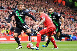 Xherdan Shaqiri of Stoke City takes on Alberto Moreno of Liverpool  - Mandatory by-line: Matt McNulty/JMP - 10/04/2016 - FOOTBALL - Anfield - Liverpool, England - Liverpool v Stoke City - Barclays Premier League