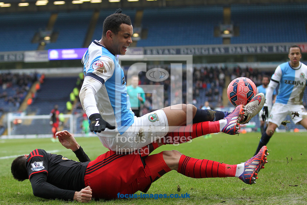 Joshua King of Blackburn Rovers and Federico Fernandez of Swansea City in action during the FA Cup match at Ewood Park, Blackburn.<br /> Picture by Michael Sedgwick/Focus Images Ltd +44 7900 363072<br /> 24/01/2015