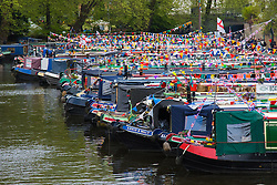 Little Venice, London, May 3rd 2015. After a dull, damp start to the day, hundreds of Londoners and narrowboat enthusiasts arrive at Paddington Basin at the juction of the Regents and the Grand Union Canals for the annual Inland Waterways Association's Canalway Cavalcade, celebrating the history and traditions of Britains vast network of canals and navigable rivers.