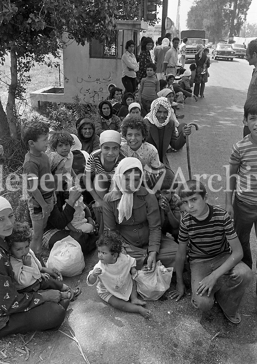 Muslims on the roadside in Tyre, Lebanon, seeking UN help for safe passage back to their homes in the South, 14/06/1978 (Part of the Independent Newspapers Ireland/NLI Collection).