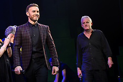 "© Licensed to London News Pictures . 12/01/2016 . Salford , UK . Writers GARY BARLOW (l) and TIM FIRTH (r) make a surprise appearance and Barlow performs in front of the audience at the Lowry Theatre ,  during the opening week of "" The Girls "" , a musical they wrote based on the story "" Calendar Girls "" , about a group of Women's Institute members in Yorkshire , who made a nude calendar . Photo credit : Joel Goodman/LNP"