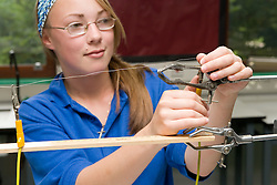 Secondary school girl investigating resistance in physics lesson,