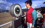 Uno de los jinetes se pesa antes del inicio de la competencia en el Hipódromo de La Rinconada. Caracas, 2000.  The jockeys are indispensable for the races of horses. La Rinconada, 2000. (Ramón Lepage/Orinoquiaphoto)