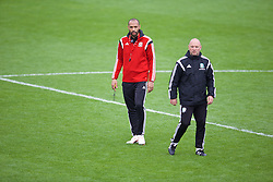 NEWPORT, WALES - Sunday, May 31, 2015: Thierry Henry gives a practical demonstration with Gareth Owen during the Football Association of Wales' National Coaches Conference 2015 at Dragon Park FAW National Development Centre. (Pic by David Rawcliffe/Propaganda)
