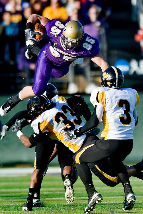 James Madison's Mike Caussin gets airborne against Towson during first quater action at Bridgeforth Stadium in Harrisonburg on Saturday..