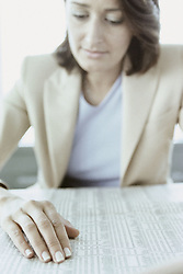 Dec. 05, 2012 - Businesswoman reading stocks and shares (Credit Image: © Image Source/ZUMAPRESS.com)