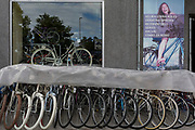 Window display of a bike shop on Dunajska Cesta (street) in the Slovenian capital, Ljubljana, on 28th June 2018, in Ljubljana, Slovenia. Ljubljana is a small city with flat terrain and a good cycling infrastructure. It was featured at eighth on the 'Copenhagenize' index listing the most bike-friendly cities in the world though bike theft is prevalent. A new bike counter on Dunajska Street declares publicly that there are many days with more than 5,000 cyclists who take a trip through there.