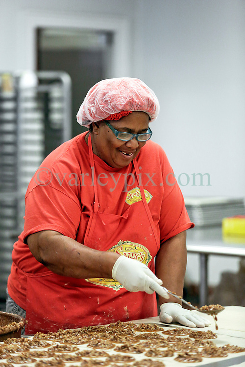 21 September 2015. New Orleans, Louisiana.<br /> Ms Robin McLinton making Aunt Sally's Pralines.<br /> Photo©; Charlie Varley/varleypix.com