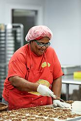 21 September 2015. New Orleans, Louisiana.<br /> Ms Robin McLinton making Aunt Sally's Pralines.<br /> Photo©; Charlie Varley/varleypix.com