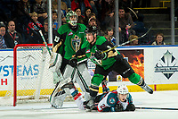 KELOWNA, CANADA - JANUARY 19:  Leif Mattson #28 of the Kelowna Rockets falls to the ice after a check by Zack Hayes #5 in front of the net of Ian Scott #33 of the Prince Albert Raiders on January 19, 2019 at Prospera Place in Kelowna, British Columbia, Canada.  (Photo by Marissa Baecker/Shoot the Breeze)