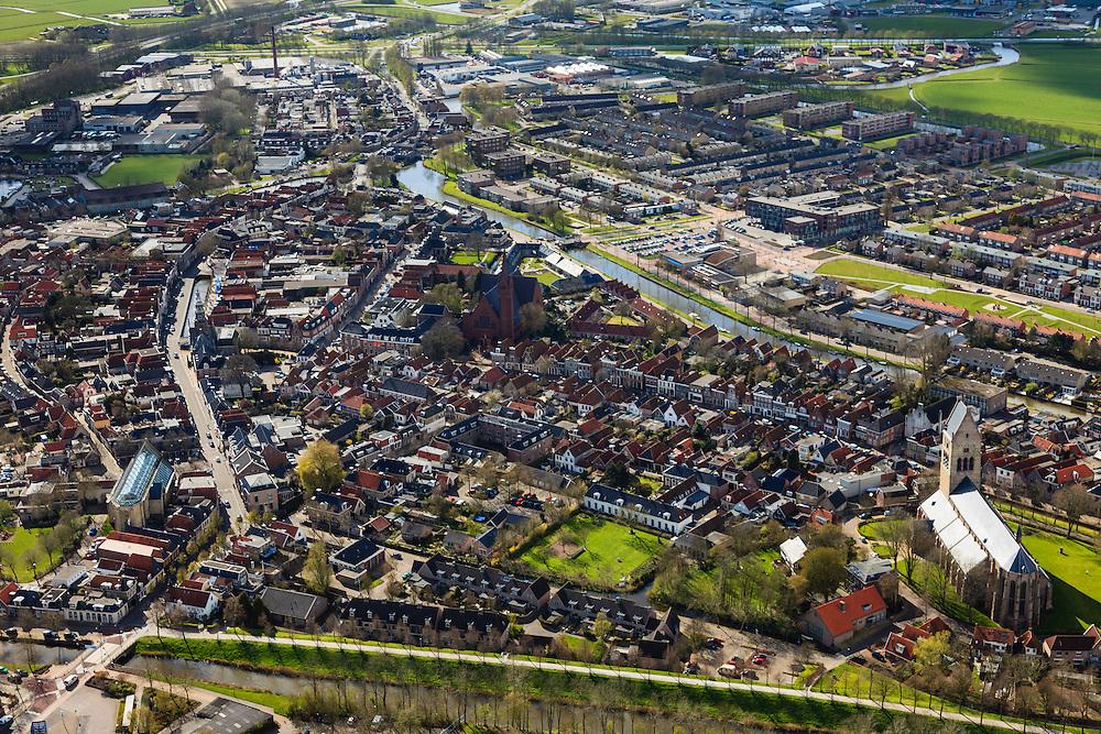 Nederland, Friesland, Gemeente Sudwest-Fryslan, 16-04-2012; Bolsward (Boalsert), centrum met Broerekerk (links, met glazen dak), Sint-Franciscuskerk (midden, baksteen) en .Martinikerk (toren met zadeldak)..Frisian city of Bolsward..luchtfoto (toeslag), aerial photo (additional fee required).foto/photo Siebe Swart