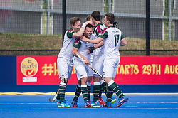 Surbiton celebrate scoring their second goal. Holcombe v Surbiton - Semi-Final - Men's Hockey League Finals, Lee Valley Hockey & Tennis Centre, London, UK on 22 April 2017. Photo: Simon Parker