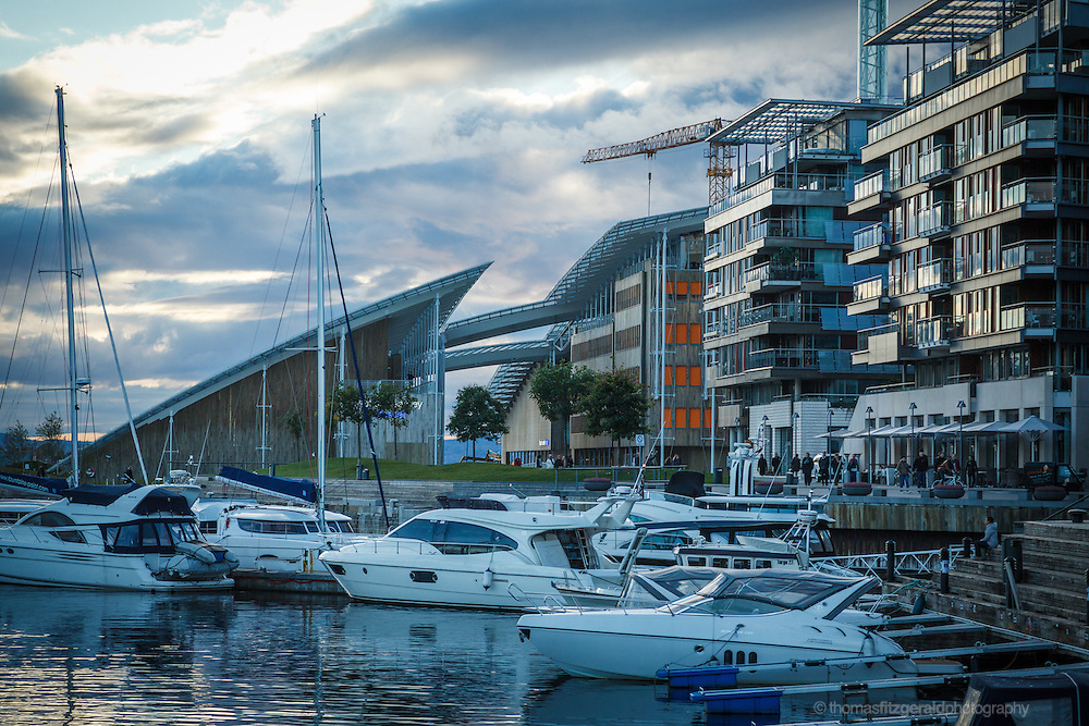Oslo, Norway, October 2012: Boats in the marina in the foreground with the Astrup Fearnley Museum in the background