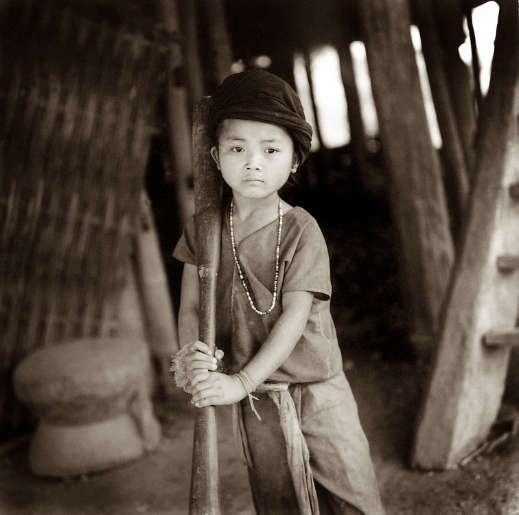 Wa Hill Tribe Girl Pounding Rice  - Eastern Myanmar.