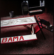 "BESSEMER, AL – OCTOBER 15, 2011: A painted bench at Gip's Place.<br /> <br /> After an altercation with the KKK in the 60's rendered his left hand badly broken, Gipson's method of guitar playing had to change. ""I had to crowd the strings,"" Gipson said, describing the method that he adopted. Today, Gipson operates Gip's Place, one of few true remaining juke joints in the country. ""Music don't care no color,"" Gipson said. ""And that's why I love blues, because blues deals with a story to tell you."""