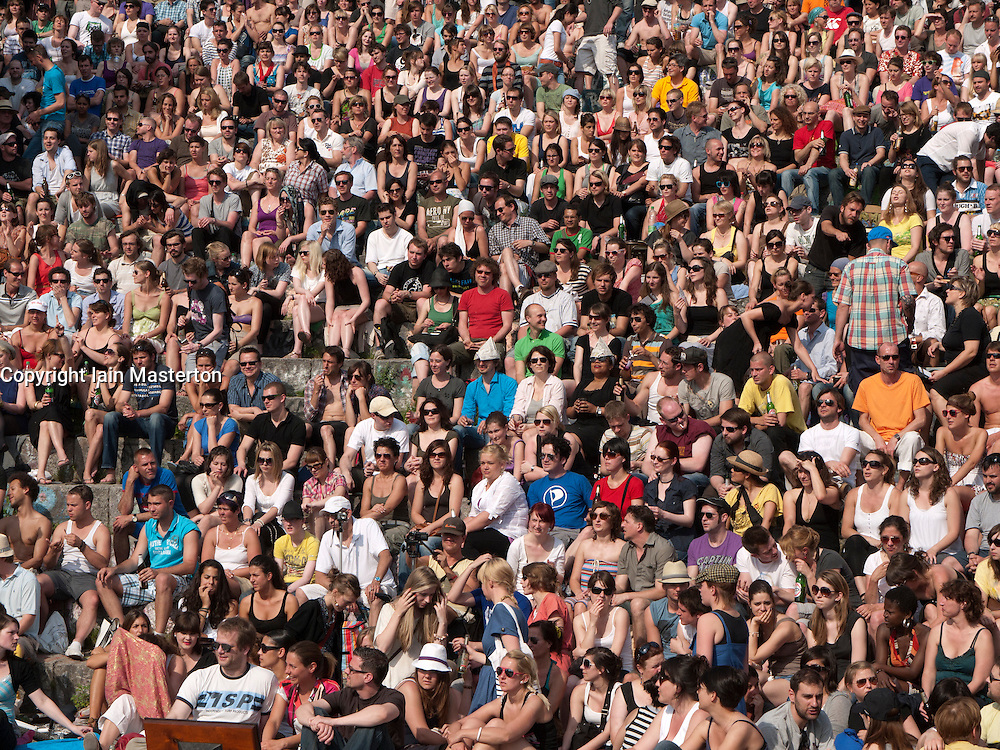 Large audience watching outdoor music gig at Mauer Park in Prenzlauer Berg in Berlin Germany